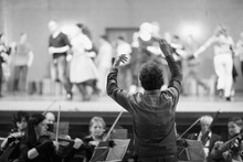 Orchestra Conductor Leading Th...
