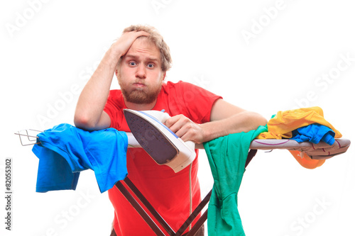 Canvas Print Man has a problem with ironing on board