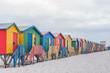 canvas print picture - Multi-colored beach huts at Muizenberg.