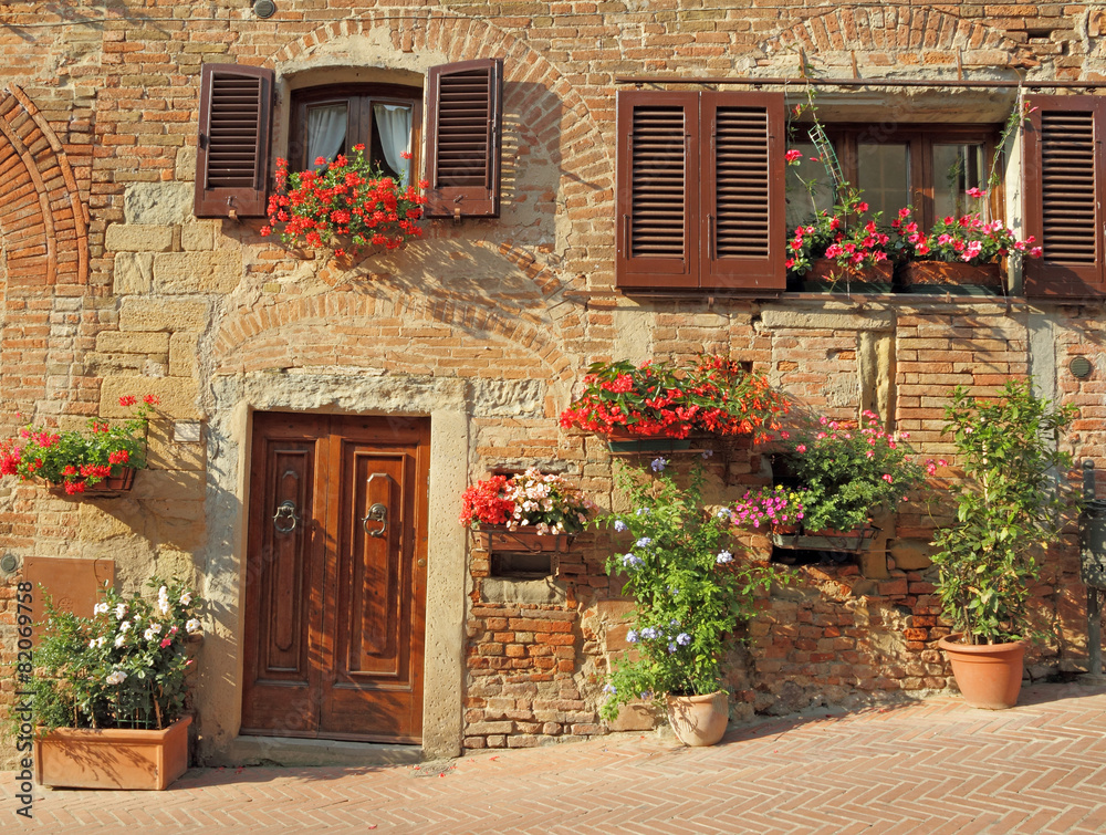 beautiful doorway to the tuscan house decorated  flowers