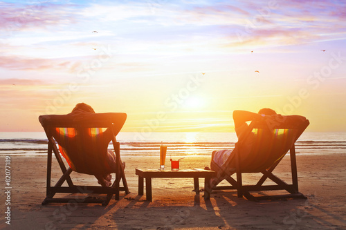 happy couple enjoy luxury sunset on the beach during summer vacations Wallpaper Mural