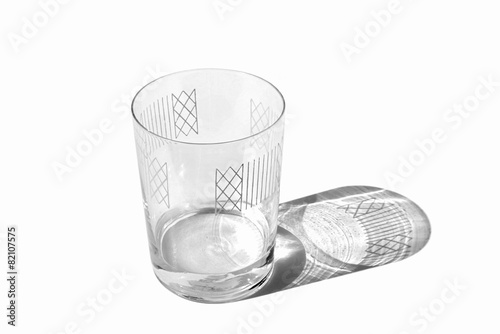 Photo  Decorated clear glass with some water isolated