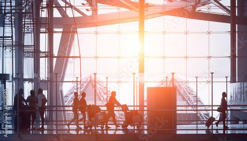 Staande foto Luchthaven commuters walking in modern airport, back light