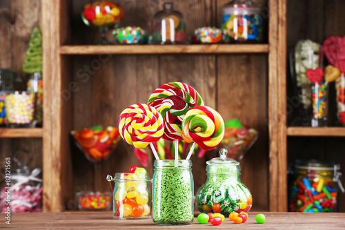 Poster Confiserie Colorful candies in jars on table in shop