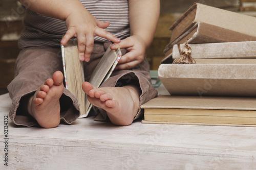 Fotografie, Obraz  Small feet of a child