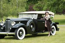 Caucasian Woman By Vintage Car
