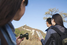 Chinese Friends Exploring Great Wall