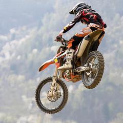 Fototapeta Motor salto con moto da cross