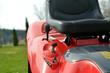 Close-up detail of garden tractor with leather seat