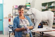 Caucasian Sculptor Working In Studio