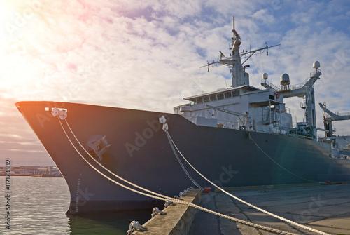 Obraz na płótnie Naval auxiliary ship docked at the harbor.