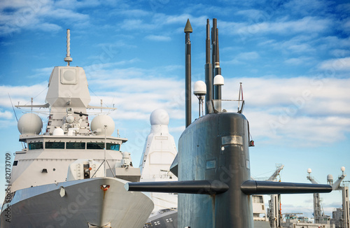 Naval fleet. Submarine and warships with guns. Fotobehang