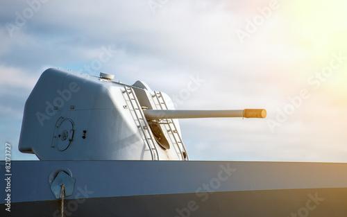Carta da parati Gun on naval ship over blue sky.