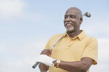 Black Man Playing Golf Outdoors