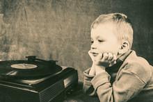 Boy Listening To Retro Music Player