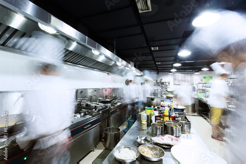 Fotobehang Restaurant modern kitchen and busy chefs