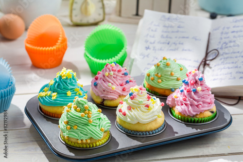 Preparation for sweet cupcakes with cream and decoration - 82192984