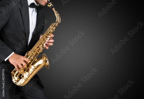 Fototapeta Sax. Black american jazz saxophone player. Vintage. Studio shot.