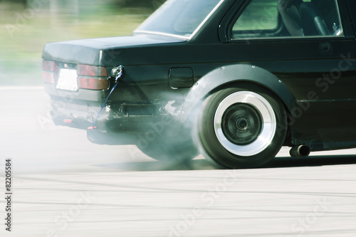 Obraz na plátne  Car Speed Drifting Burnout Wheel