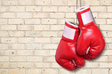 Boxing gloves over brick wall background