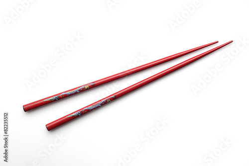 Fotografie, Obraz  Red wooden chopsticks on white background