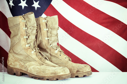 Old combat boots with American flag Fotobehang