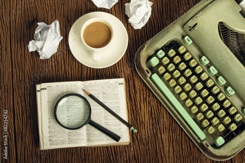 Fotografía  The dictionary consider under a magnifier on writer's desk with