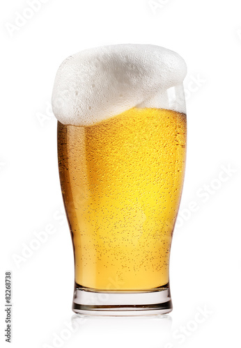 Foto op Canvas Alcohol Glass of light beer with white foam