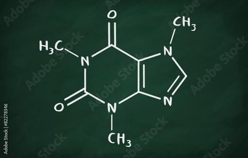 Foto Chemical formula of Caffeine on a blackboard