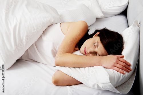 Fototapeta Woman sleeping in bed. obraz na płótnie