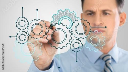 Fotografía  Planning. Businessman showing database structure