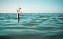 Hand In Sea Water Asking For H...