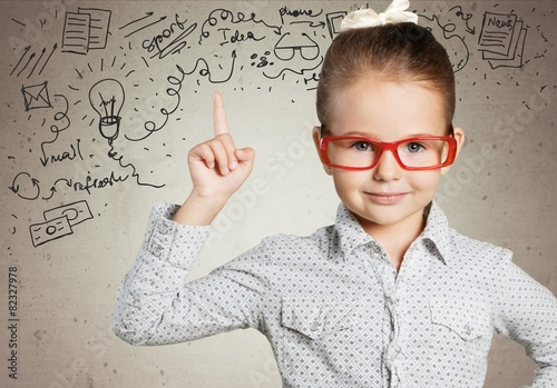 Fotografia  Boy. Genius boy in red glasses near blackboard with formulas