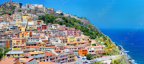 Photo  Colorful houses and a castle of Castelsardo town