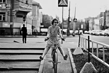 Cheerful Girl On A Bicycle Mov...