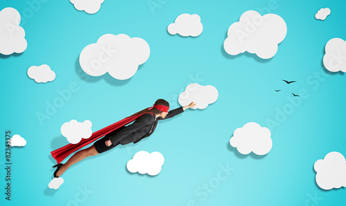 Photo  superwoman in red mask and cloak