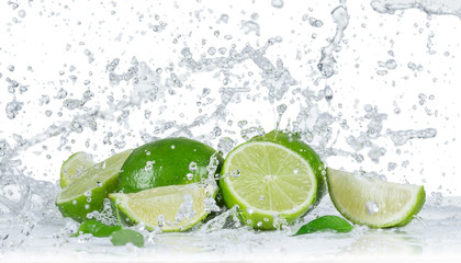 Fototapeta Owoce Limes with water splash