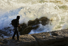 Fishermen On The Coast With Big Waves In Corunna Spain