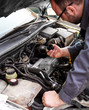 Close up of auto mechanic opens the oil cap