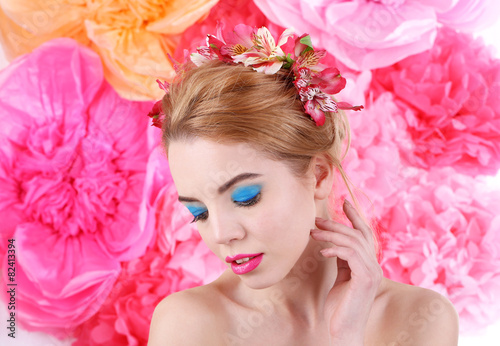 Fotobehang womenART Portrait of young woman with flowers in hair on bright pink background
