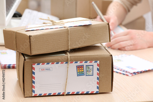 Fotografia  Cardboard boxes on work place in post office