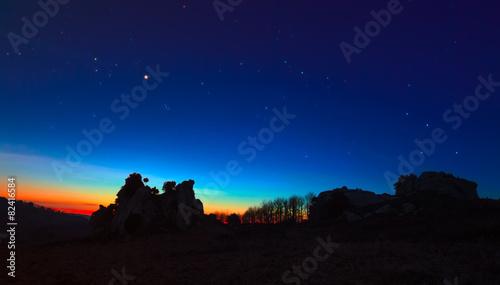 Fotografie, Obraz  Argimusco twilight with Venus Taurus Cassiopea and Pleiades