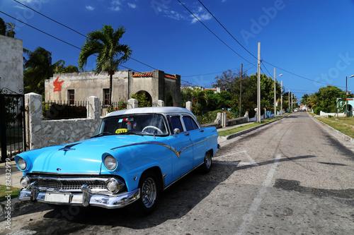 Street scene with vintage car in Havana, Cuba Canvas Print