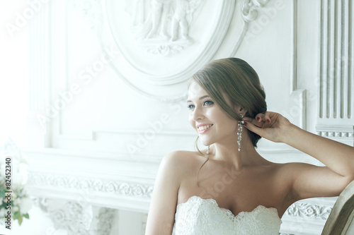 Fotografie, Obraz  Beautiful Blond Bride Happy Smiling In Rays Of Light