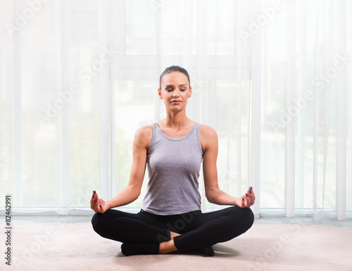 Woman meditating in a bright room