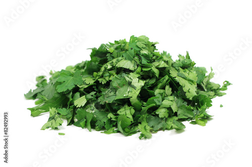 a handful of chopped parsley on a white background