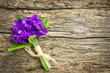 Beautiful bouquet of violets on the wooden background