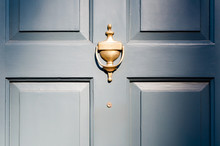 Background Of Vintage Blue Painted Door And Knocker Vignette