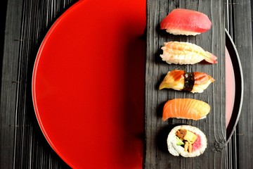 Fototapeta Mixed sushi platter on red tray