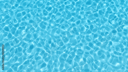 Fotografia Blue swimming pool rippled water detail